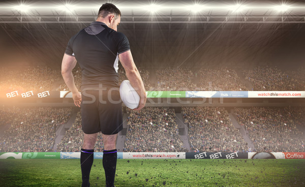 Composite image of tough rugby player holding ball Stock photo © wavebreak_media