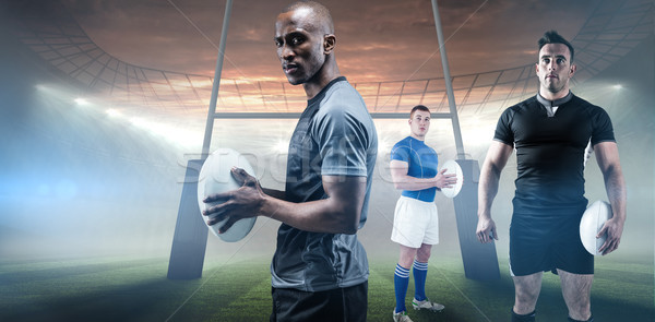Stock photo: Composite image of rugby player holding rugby ball