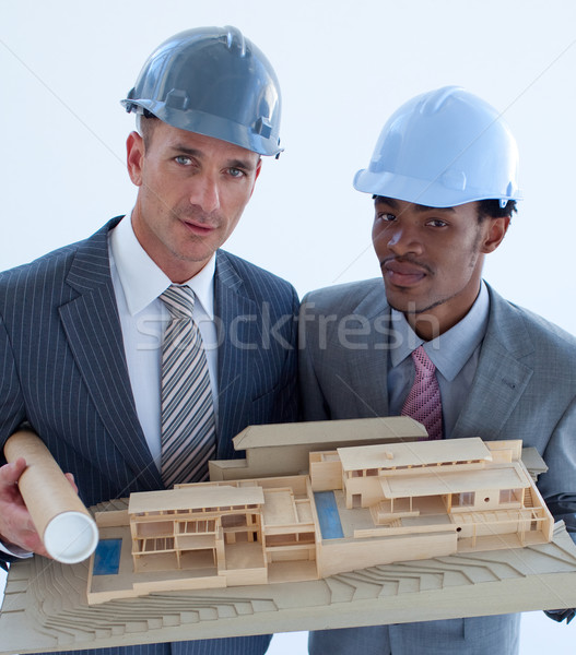 Close-up of architects holding a model house in office Stock photo © wavebreak_media