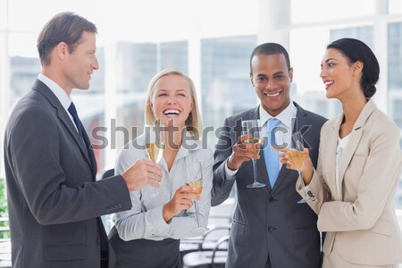 Fortunate business team toasting with Champagne Stock photo © wavebreak_media