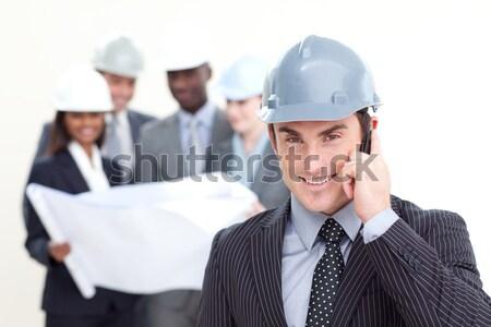 Sorridente capacete de segurança equipe edifício urbano indústria Foto stock © wavebreak_media