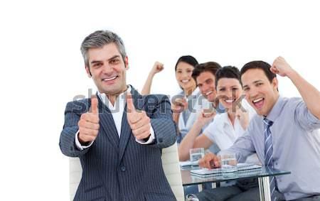 Fortunate international business team with thumbs up Stock photo © wavebreak_media