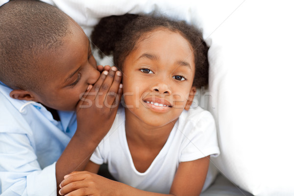Adorable little boy whispering something to his sister Stock photo © wavebreak_media
