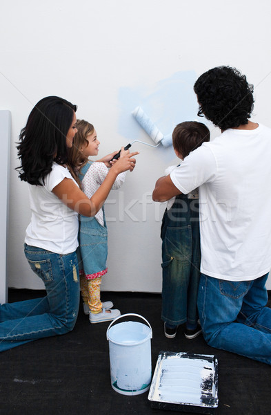 Loving parents helping their children paint Stock photo © wavebreak_media