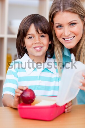 Smiling little boy and his mother preparing his snack Stock photo © wavebreak_media