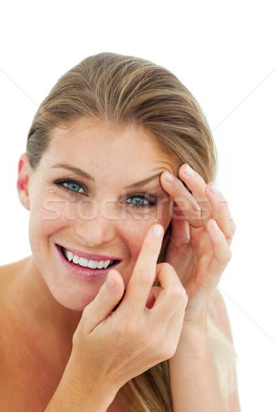 улыбающаяся женщина контактная линза изолированный белый глаза лице Сток-фото © wavebreak_media