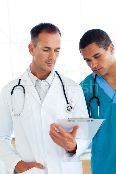 Two attractive doctors talking about a patient Stock photo © wavebreak_media