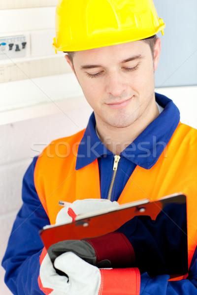 Elektricien macht plan werk glimlach Stockfoto © wavebreak_media