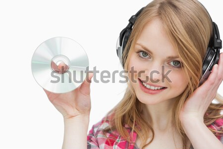 Delighted woman holding a cd-rom  Stock photo © wavebreak_media
