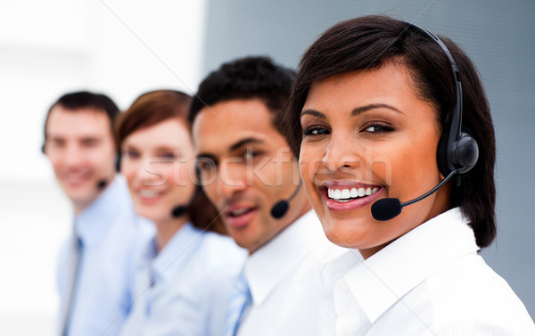 Ethnic businesswoman with headset on smiling at the camera in a call center Stock photo © wavebreak_media