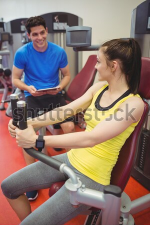 beautiful woman using a rower with her boyfriend in a fitness center Stock photo © wavebreak_media