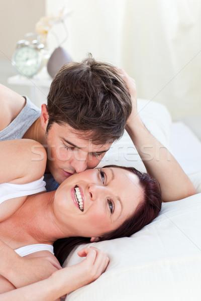 Zärtlich Paar Bett Schlafzimmer home weiblichen Stock foto © wavebreak_media