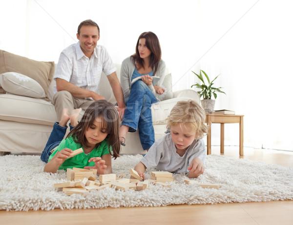Feliz pais sofá olhando crianças jogar Foto stock © wavebreak_media