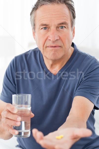 Malati uomo pillole home persona Foto d'archivio © wavebreak_media