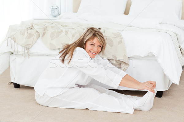 Mature woman doing her stretches at home Stock photo © wavebreak_media
