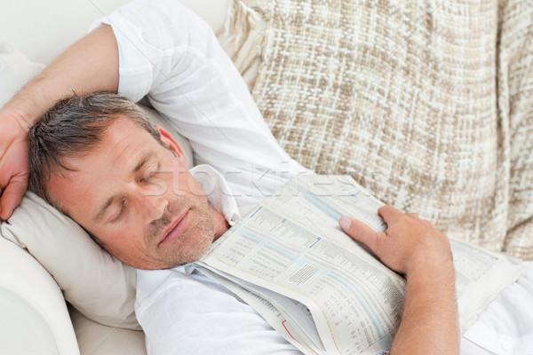 Kimerült férfi alszik kanapé otthon hírek Stock fotó © wavebreak_media