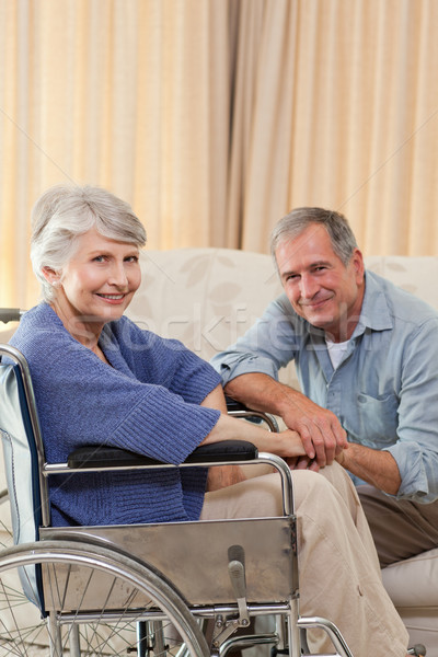 Stock photo: Mature couple looking at the camera
