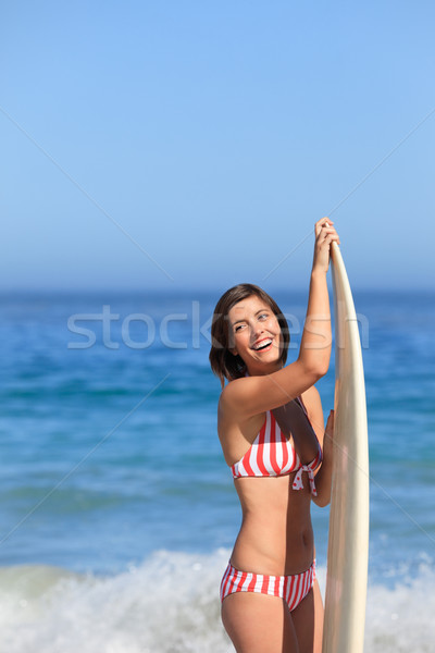 Lovely woman with her surfboard Stock photo © wavebreak_media