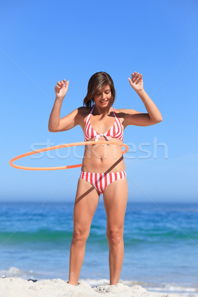 Woman playing with a hula hoop Stock photo © wavebreak_media