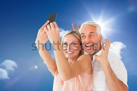 Anya lánygyermek szélmalom lány mosoly szeretet Stock fotó © wavebreak_media