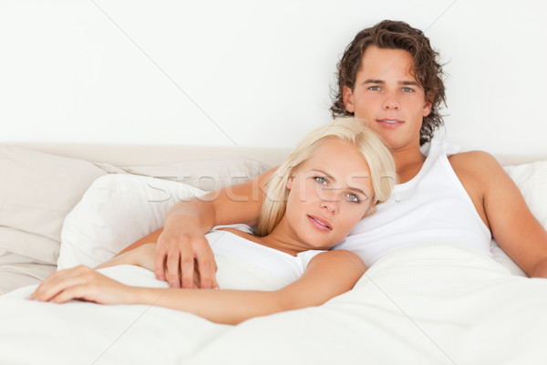 Serene couple lying on a bed in their bedroom Stock photo © wavebreak_media
