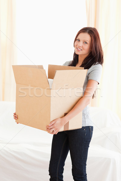 A woman is transporting a filled cardboard Stock photo © wavebreak_media