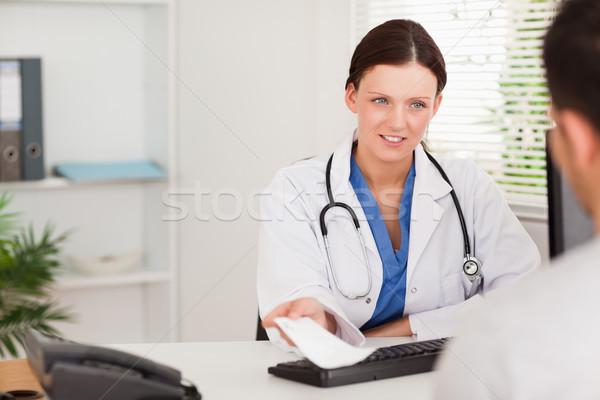 A female doctor is giving a patient a prescription Stock photo © wavebreak_media