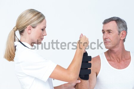 Cute couple going to practice yoga against a white background Stock photo © wavebreak_media