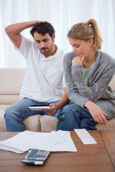 Retrato casal olhando sala de estar casa Foto stock © wavebreak_media