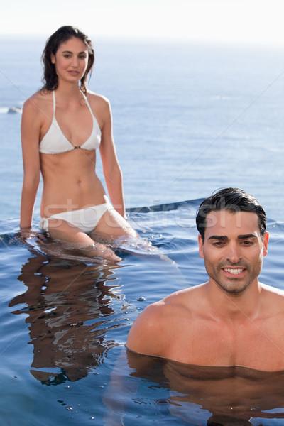 Portre çift rahatlatıcı yüzme havuzu su yüz Stok fotoğraf © wavebreak_media