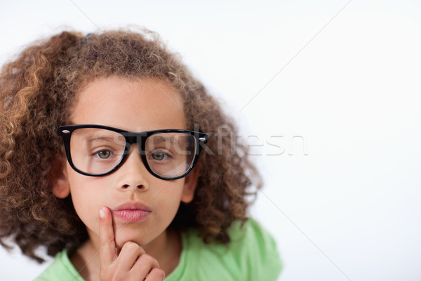 Young girl thinking against a white background Stock photo © wavebreak_media