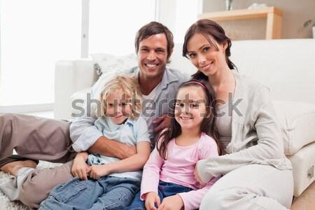 Portrait famille détente salon regarder caméra Photo stock © wavebreak_media