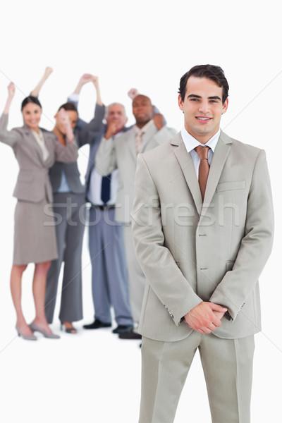 бизнесмен команда за белый улыбка Сток-фото © wavebreak_media