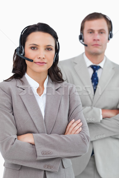 Call center agents with headsets and arms folded against a white background Stock photo © wavebreak_media