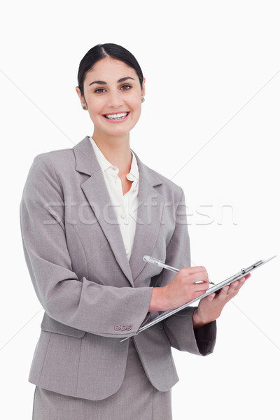 Smiling businesswoman ready to take notes against a white background Stock photo © wavebreak_media