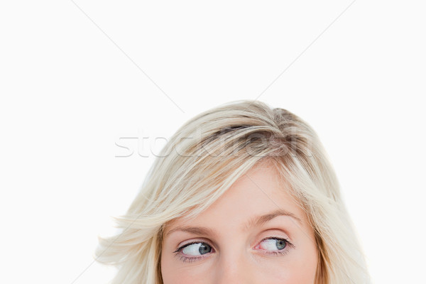 Szemek fiatal szőke nő néz oldal fehér Stock fotó © wavebreak_media