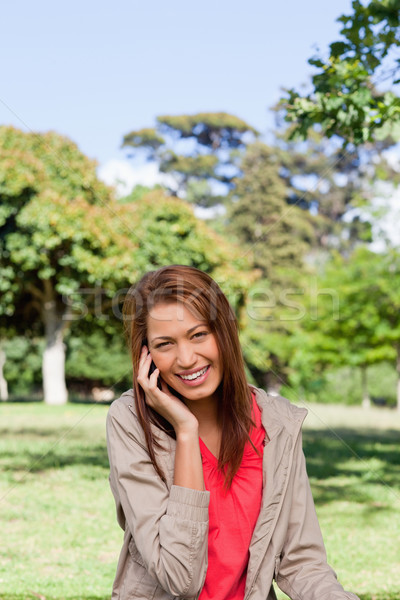 Young woman happy smiling while looking into the camera in an open grassland area Stock photo © wavebreak_media