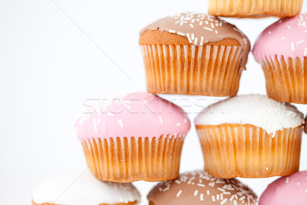 Close up on a pyramid of muffins against a white background Stock photo © wavebreak_media