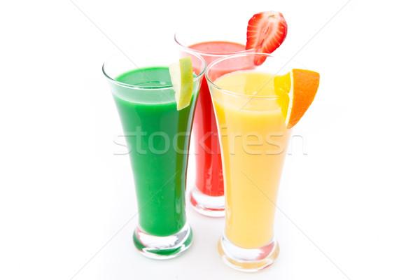 Fruit pieces in three full glasses against white background Stock photo © wavebreak_media