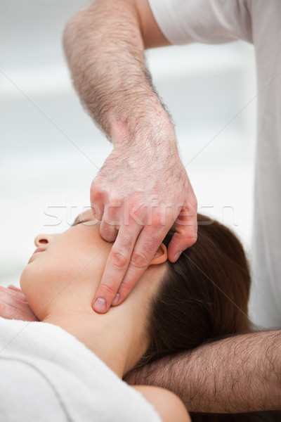 Therapist pressing with two fingers on the neck of his patient in a room Stock photo © wavebreak_media