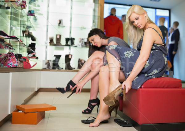 Women sitting trying on shoes Stock photo © wavebreak_media