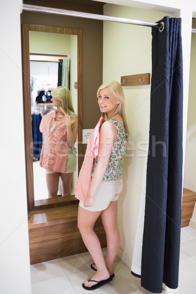 Woman standing in a changing room  smiling  Stock photo © wavebreak_media