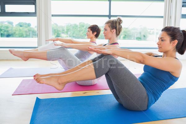 Kadın tekne poz yoga sınıf uygunluk Stok fotoğraf © wavebreak_media