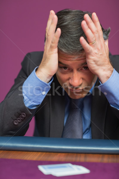 Homme tête mains casino visage table Photo stock © wavebreak_media