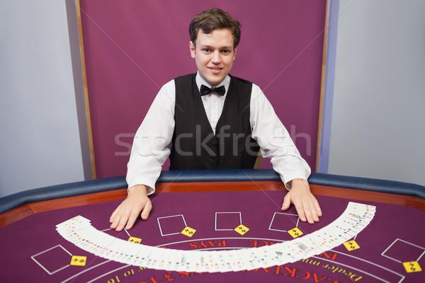 Sorridere concessionario fuori deck carte casino Foto d'archivio © wavebreak_media