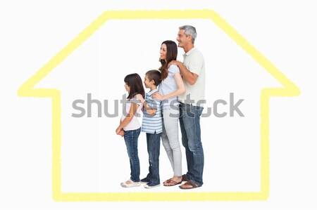 Smiling family standing with a blue house illustration with ener Stock photo © wavebreak_media