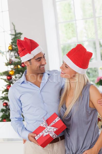 Smiling couple at christmas Stock photo © wavebreak_media