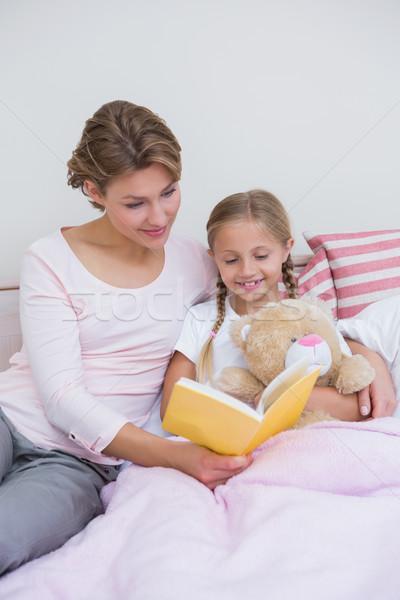 Mother with her daughter at bedtime Stock photo © wavebreak_media