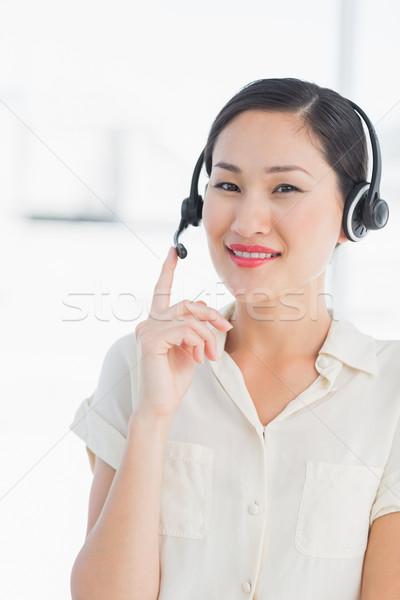 Beautiful smiling female executive with headset Stock photo © wavebreak_media