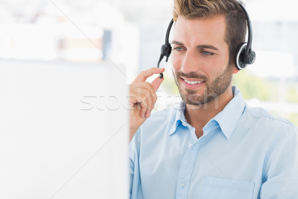 Közelkép lezser fiatalember headset számítógéphasználat fényes Stock fotó © wavebreak_media